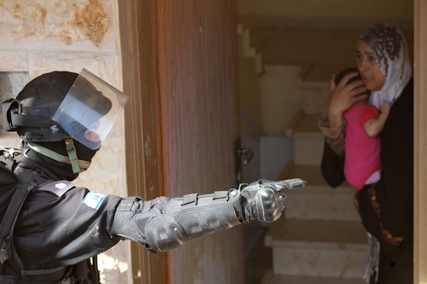 Illustrative photo of an Israeli riot police officer giving orders to an Arab woman in Umm el-Fahm. (Nati Shohat/FLASH90)