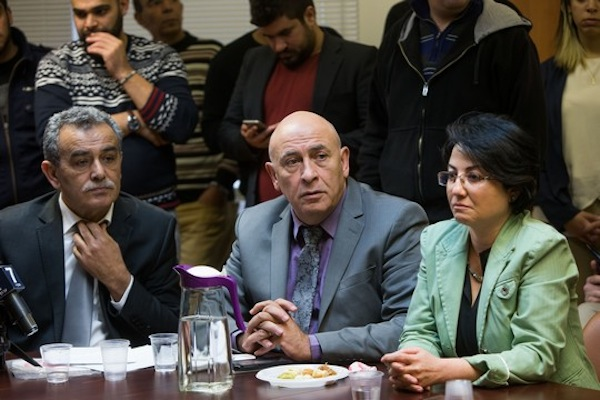 Joint Arab List members Jamal Zahalka (L), Haneen Zoabi (R) and Basel Ghattas at the weekly Joint List meeting in the Knesset, February 8, 2016. (Yonatan Sindel/Flash90)