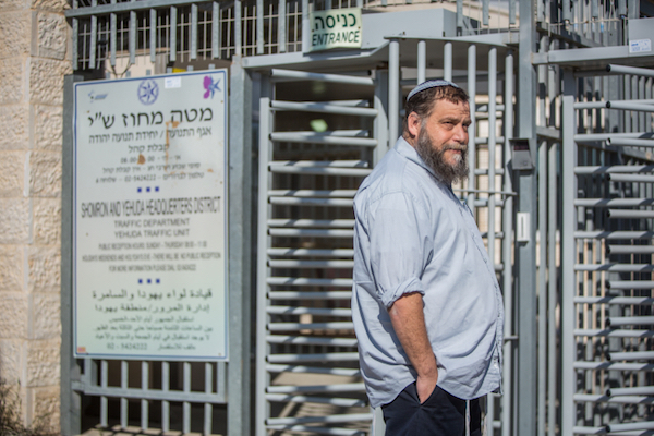 Radical right-wing activist Benzi Gopstein arrives at an Israeli police station in the West Bank for questioning, February 25, 2016. (Yonathan Sindel/Flash90)