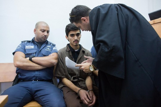 Fares Sritah, 19, from the Jerusalem neighborhood Beit Hanina neighborhood, is brought to Jerusalem's District Court, August 13, 2015. Sritah was charged with attempting to join Islamic State. (Yonatan Sindel/Flash90)