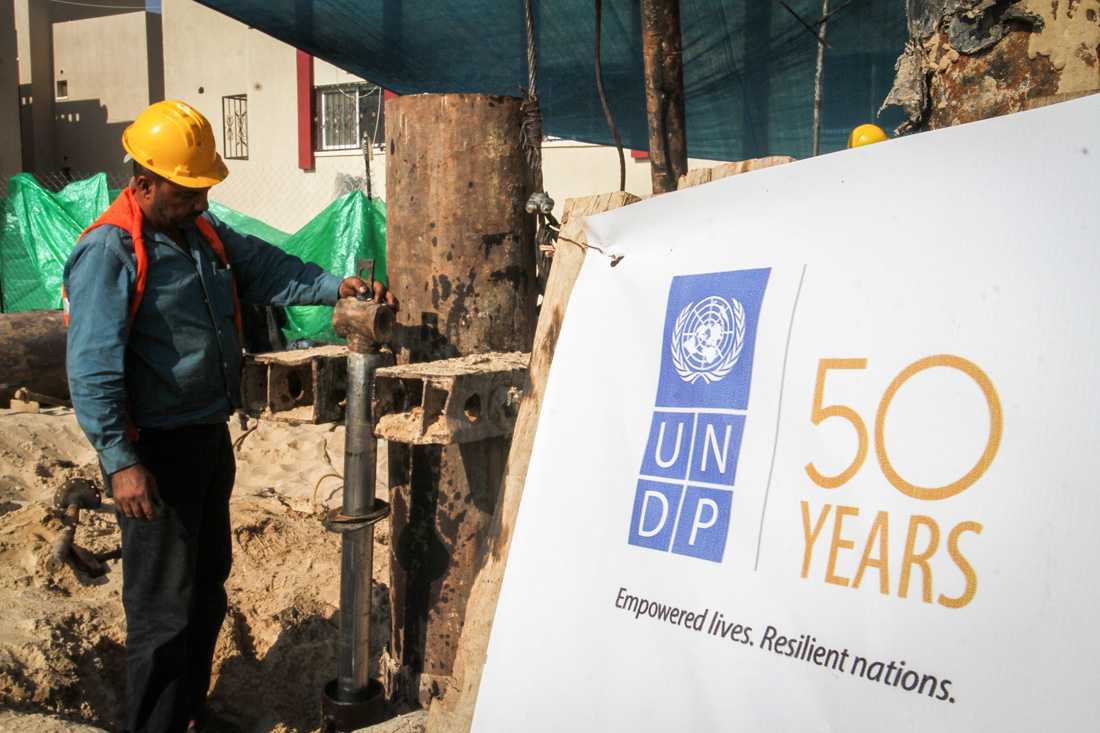 UN Development Program employees oversee a UNDP reconstruction project in the Gaza Strip, which sustained heavy damage during the 2014, Rafah, August 9, 2016. (Abed Rahim Khatib/ Flash90)