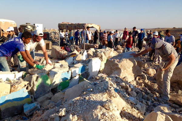 Jewish activists work with the Palestinian residents of Umm el-Kheir to rebuild structures demolished by Israeli military authorities, South Hebron Hills, West Bank, September 10, 2016. (Sarah Stern)