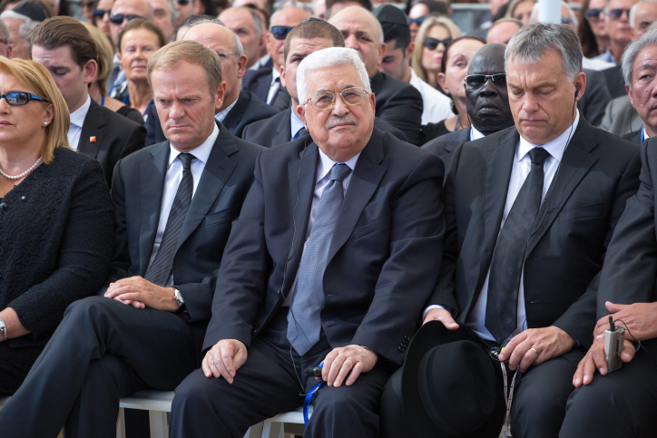 Palestinian Authority President Mahmoud Abbas seen during the funeral ceremony for Shimon Peres, Mount Herzl, Jerusalem, September 30, 2016. (Emil Salman/Flash90)