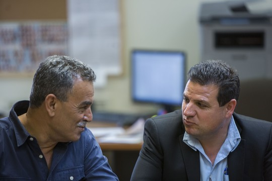 Leader of the Joint Kist, Ayman Odeh (R) with MK Jamal Zahalka, during the weekly Joint List meeting in the Knesset, June 1, 2015. (Yonatan Sindel/Flash90)