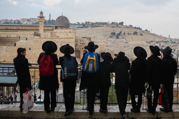 Ultra-Orthodox Jews look out over the Western Wall and the Temple Mount/Haram al-Sharif, December 17, 2015. (Esther Rubyan/Flash90)