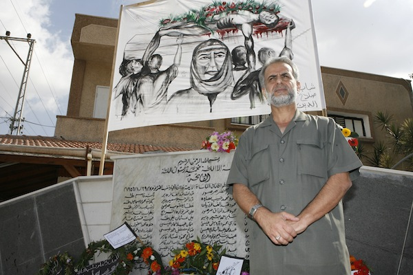 Knesset Member Ibrahim Sarsur stands by a monument for the victims of the Kafr Qasim massacre, October 28, 2007. (Michal Fattal/Flash90)