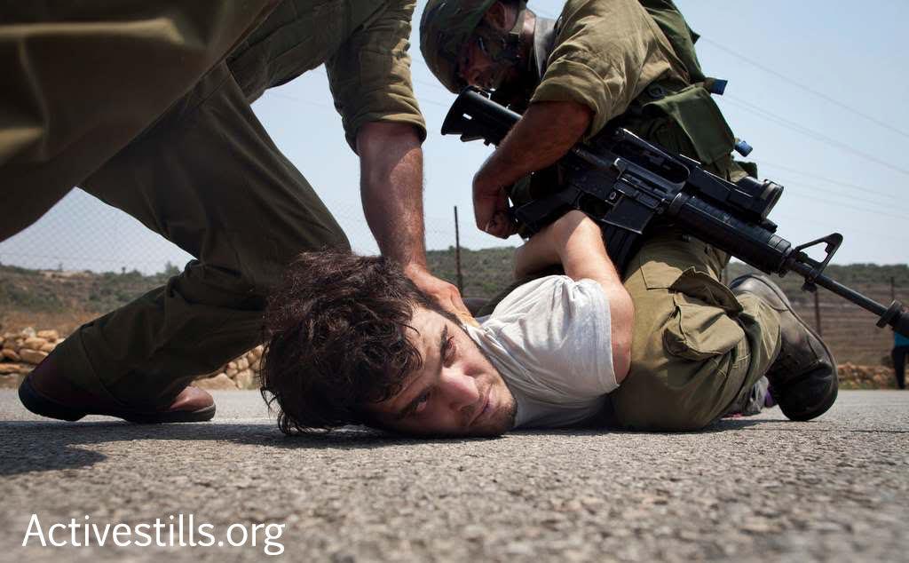 Israeli activist Renen Raz is seen arrested by Israeli soldiers during a demonstration in the West Bank village Nabi Saleh. Raz passed away in October 2016. (Activestills.org)