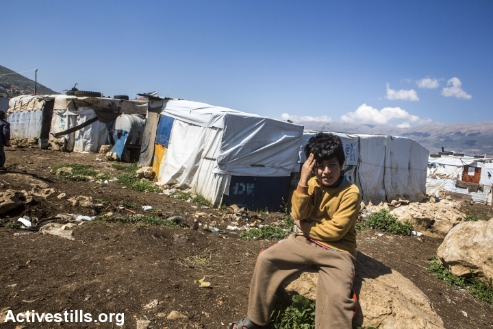 A Syrian child sits near an informal camp for Syrian refugees in the Bekaa Valley, near the village of Jib Janin, eastern Lebanon, April 14, 2016. (Anne Paq/Activestills.org)