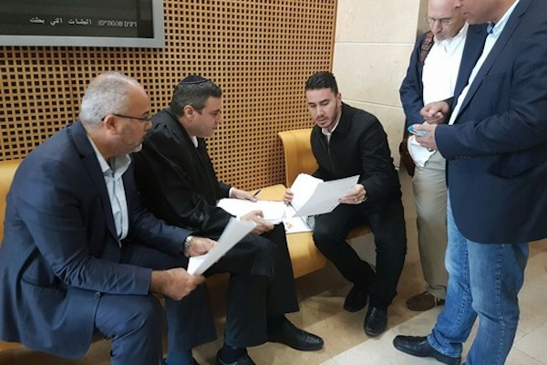 Anas Abudaabes's attorneys confer with members of the Joint List at court in Be'er Sheva. (Courtesy of Joint List spokesperson)