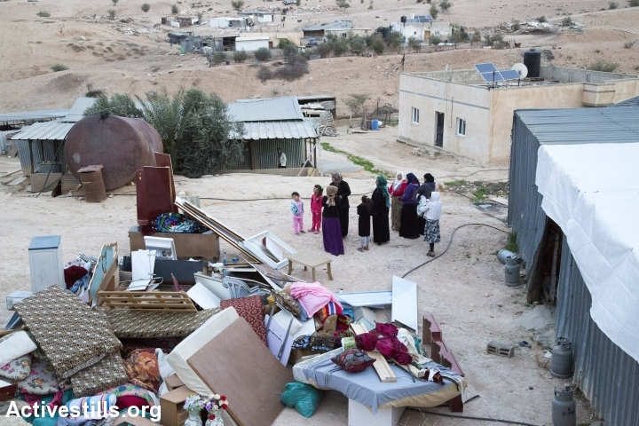 The contents of entire homes are left in piles outside of the buildings Israeli authorities said they were coming to demolish, Umm el-Hiran, the Negev, November 22, 2016. (Keren Manor/Activestills.org)