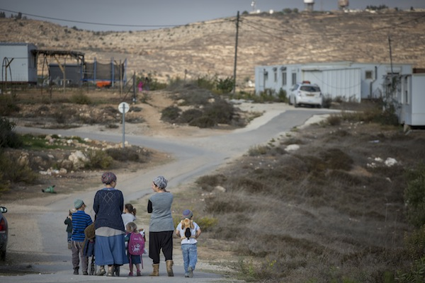 Jewish residents of 'illegal' settlement outpost Amona, November 17, 2016. (Miriam Alster/Flash90)