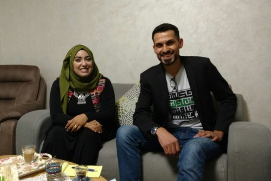 Anas Abudaabes and his wife, Ruqayya Sabah, in their home in Rahat, November 30, 2016. (Orly Noy)