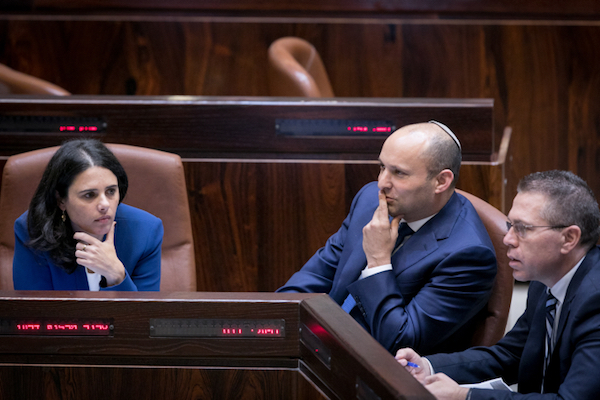 Pro-annexation Jewish Home ministers Ayelet Shaked and Naftali Bennett during a preliminary vote on the 'Regulation Law' to legalize 'illegal' settlement outposts, November 16, 2016. (Yonatan Sindel/Flash90)