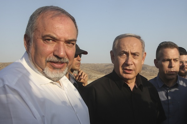 Israeli Prime Minister Benjamin Netanyahu and Israeli Defense Minister Avigdor Liberman visit the new fence between Israel and Tarqumiyah in the West Bank, July 20, 2016. (Marc Israel Sellem/Flash90)