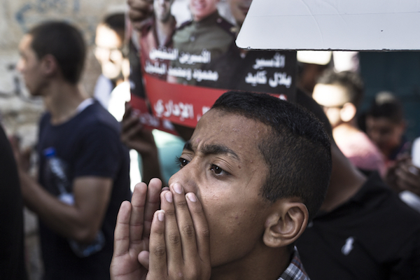 A Palestinian teen at a protest in solidarity with hunger-striking Palestinian prisoners in Israel, September 13, 2016. (Sebi Berens/Flash90)