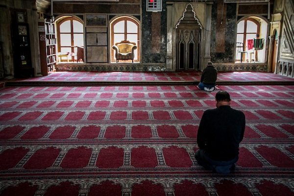 Muslim men pray inside a mosque in the northern city of Acre, March 3, 2015. (Marcelo Sus/Flash90)