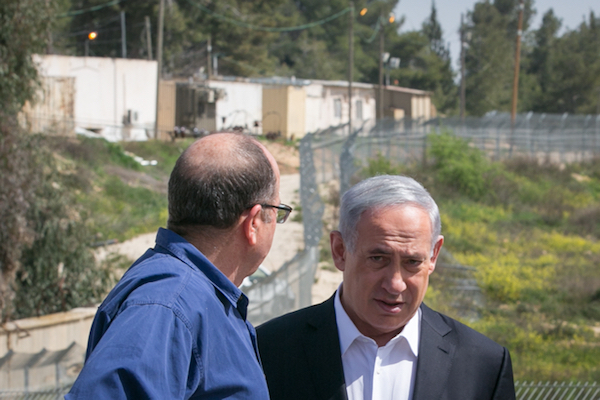 File photo of Prime Minister Benjamin Netanyahu outside the West Bank settlement of Beit El. Directly abutting the de facto Palestinian capital of Ramallah and far from the Green Line, Beit El is considered a 'consensus settlement.' (Ohad Zwigenberg/POOL)