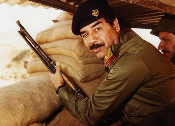 Saddam Hussein pictured in the trenches during the Iran-Iraq War. (AFP/Getty-images)