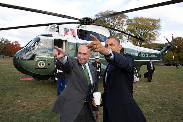 President Barack Obama is met by Sen. Chuck Schumer, D-N.Y., upon arrival aboard Marine One at the Prospect Park landing zone in New York, N.Y., October. 25, 2013. (Official White House Photo by Pete Souza)