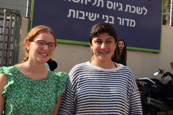 Tamar Alon and Tamar Ze'evi stand outside the IDF's Tel Hashomer induction base where they declared their refusal to serve in the army, and be sentenced to prison, Tel Aviv, November 16, 2016. (Haggai Matar)