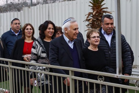 Former Israeli President Moshe Katsav walks with his wife Gila, after releasing from Ma'asiyahu Prison where he served his sentence, December 21, 2016. (Aloni Mor/Flash90)