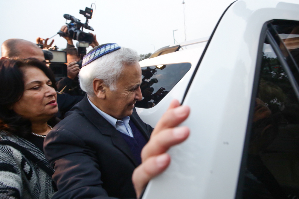 Former Israeli president Moshe Katsav enters a car upon being released from prison, December 21, 2016. Katsav served just over five years in prison for rape and other sexual offenses. (Aloni Mor/Flash90)