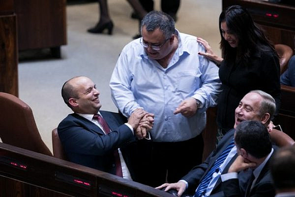 Education Minister Naftali Bennett, MK David Bitan, Culture Minister Miri Regev and Prime Minister Benjamin Netanyahu attend a Knesset plenum session, December 5, 2016. (Yonatan Sindel/Flash90)