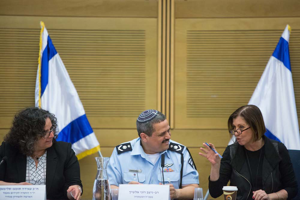 Chairwoman of the Committee on the Status of Women MK Aida Toma Sliman (L), Israeli Police Commissioner Roni Alsheikh (C), and MK Zehava Galon at a parliamentary hearing on sexual harassment in the Israeli National Police, the Knesset, Jerusalem, March 29, 2016. (Yonatan Sindel/Flash90)