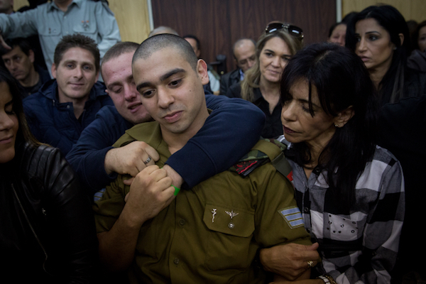 Israeli soldier Elor Azaria in court to hear the verdict in his manslaughter trial for shooting an unarmed Palestinian attacker in the head, January 4, 2017. (Miriam Alster/Flash90)