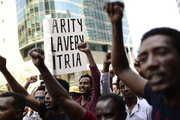 Eritrean asylum seekers protest in front of the European Union embassy in Ramat Gan, near Tel Aviv, calling for the EU to try the Eritrean leadership for crimes against humanity, on June 21, 2016. (Tomer Neuberg/Flash90)
