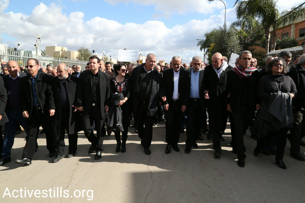 Members of Knesset from the Joint List march in Qalansuwa during a mass rally against home demolitions, January 13, 2017. (Keren Manor/Activestills.org)
