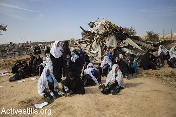 Women weep outside a demolished home in Umm el-Hiran, January 18, 2017. (Keren Manor/Activestills)
