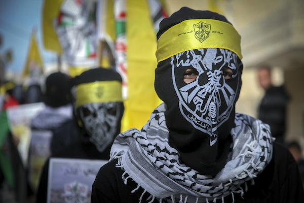A Masked Palestinian from the Fatah movement is seen during clashes with Israeli soldiers following the funeral of 17-year-old Palestinian Qusai Al-Amour, who Israeli and Palestinian officials said was shot dead by Israeli Border Police during clashes with protesters ,Tuqu, West Bank, January 17, 2017. (Wisam Hashlamoun/Flash90)