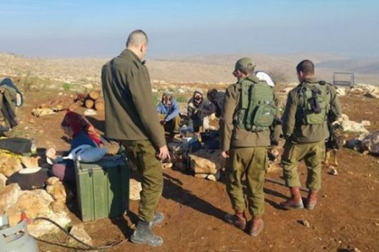Israeli soldiers being hosted at an illegal outpost, Jordan Valley, West Bank, Jan 5, 2017. (Guy Hircefeld)