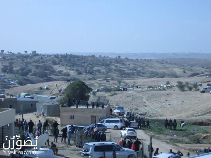 Residents were prevented from leaving the area of the village mosque for several hours while demolitions were carried out, Umm el-Hiran, January 18, 2017. (Yuṣawiruna Project, Negev Coexistence Forum)
