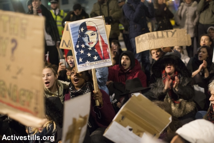 Demonstrators protest outside Downing Street against U.S. President Donald Trump in central London, January 30, 2017. The protest was held against Trump's planned visit to the UK and following an executive order restricting immigration and refugee requests from seven Muslim countries. (Oren Ziv/Activestills.org)