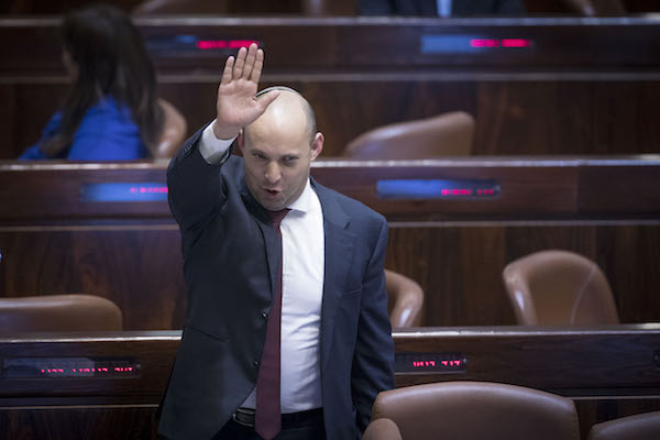 Jewish Home party leader Naftali Bennett at a Knesset plenum session to vote on the formalization law, Jerusalem, February 6, 2017. (Yonatan Sindel/Flash90)