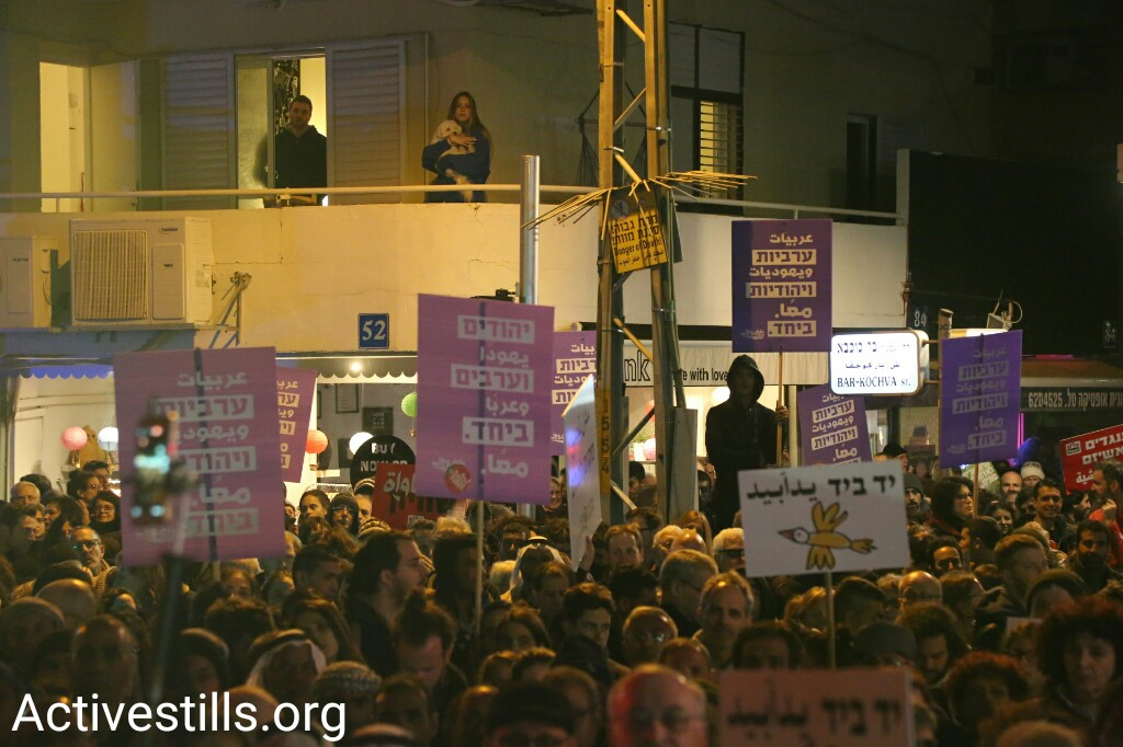 Thousands of Palestinians and Jews march in Tel Aviv against home demolitions and in support of equality for all, February 4, 2017. (Keren Manor/Activestills.org)