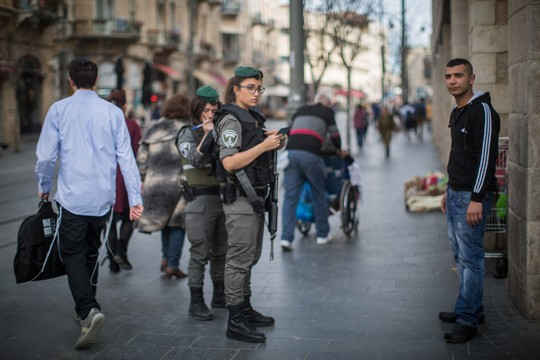 Israeli Border Police check the ID of a young Arab man on Jaffa Road, central Jerusalem, February 18, 2016. (Hadas Parush/Flash90)