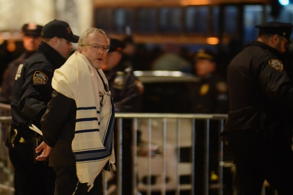 A rabbi is arrested by the NYPD during a protest against the refugee ban outside Trump International Hotel in Manhattan, February 6, 2017. (Gili Getz)