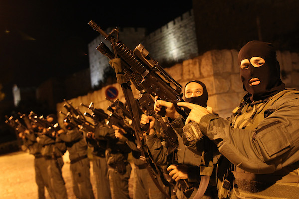 Armed Israeli riot police officers line up outside the walls of Jerusalem's Old City, May 3, 2010. (Nati Shohat/Flash90.)