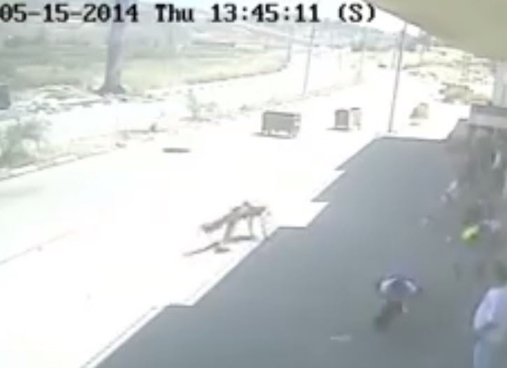 Image from CCTV footage of Nawara falling after being shot.