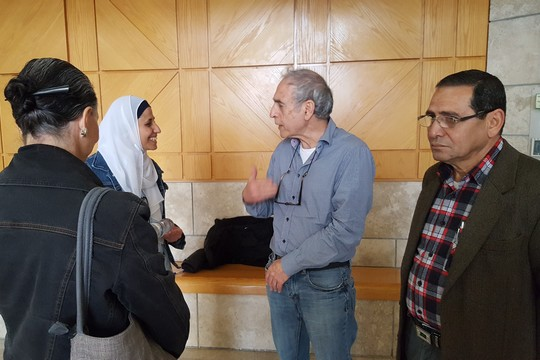 Dareen Tatour (left) and Professor Calderon (center) speak at the Nazareth Magistrates Court, March 19, 2017. (Yoav Haifawi)