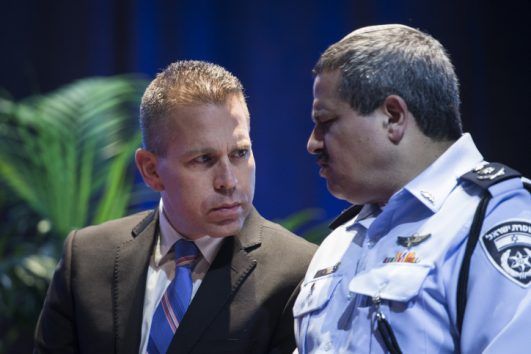 Public Security Minister Gilad Erdan and Chief of Police Roni Alsheikh attend a ceremony for Israeli police at the Police National College, Bet Shemesh, September 22, 2016. (Hadas Parush/Flash90)