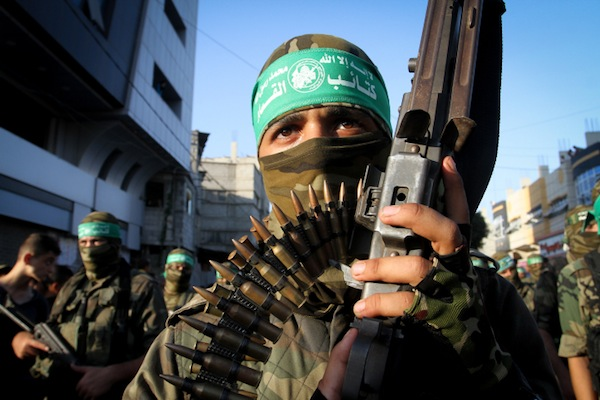 Palestinian members of the al-Qassam Brigades, the armed wing of the Hamas movement, take part in military parade marking the second anniversary of the killing of Hamas's military commanders, Mohammed Abu Shamala and Raed al-Attar, August 21, 2016 in Rafah in the southern Gaza Strip. (Abed Rahim Khatib/Flash90)