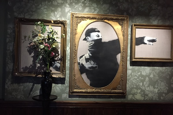 A version of Banksy's famous protester piece, The Walled Off Hotel, Bethlehem, March 3, 2017. (Haggai Matar)