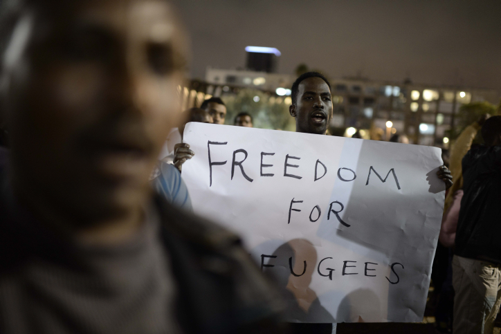 Asylum seekers from Eritrea and Sudan protest the Israeli government's refusal to review asylum requests, and the state's detention policies, at a demonstration held at Rabin Square, central Tel Aviv. March 29, 2014. (Tomer Neuberg/Flash90)