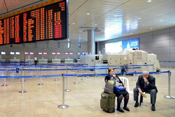 Passengers sit in an empty departures hall at Tel Aviv's Ben Gurion Airport. (Yossi Zeliger/Flash90)