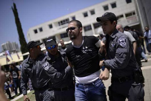 Israeli police detain a protester during a rally marking the anniversary of the Nakba, Tel Aviv University, May 20, 2015. (Tomer Neuberg/Flash90)