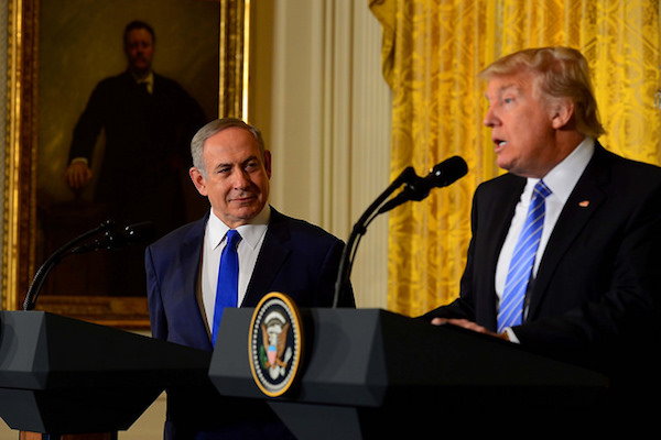 'I'd like to see you hold back on settlements for a little bit. We'll work something out,' Donald Trump tells Benjamin Netanyahu at a White House press conference, February 15, 2017. (Avi Ohayon/GPO)